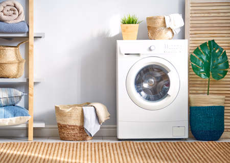 Foto de Interior of a real laundry room with a washing machine at home - Imagen libre de derechos