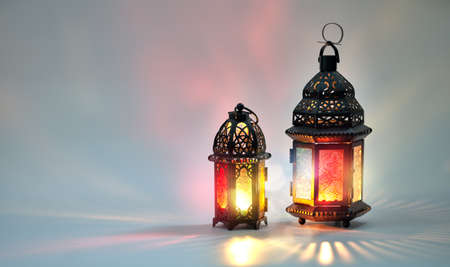 Photo for Ornamental Arabic lantern with burning candle glowing on white background. Festive greeting card, invitation for Muslim holy month Ramadan Kareem. - Royalty Free Image