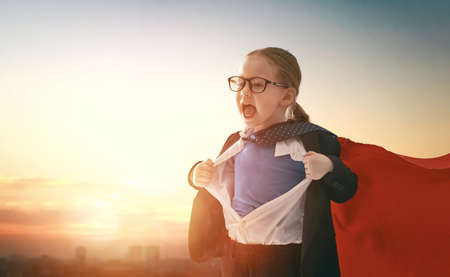 Foto de superhero businessman child on sunset background. the concept of success, leadership and victory in education. - Imagen libre de derechos