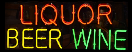 A multi colored neon sign reading Liquor Beer Wine mural