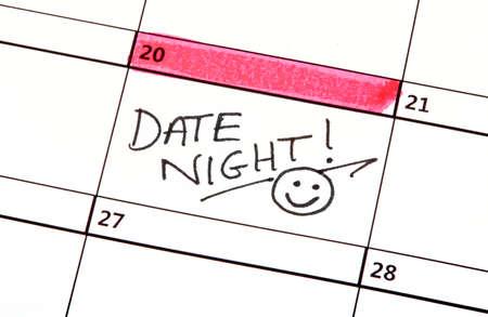 Foto de A Date Night Highlighted on a Calendar. - Imagen libre de derechos
