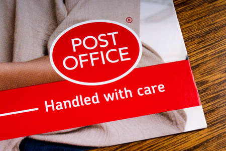 Foto de LONDON, UK - MARCH 27TH 2018: A close-up of the Post Office icon, pictured on an information leaflet, on 27th March 2018.  Post Office Ltd is a retail post office company in the UK. - Imagen libre de derechos