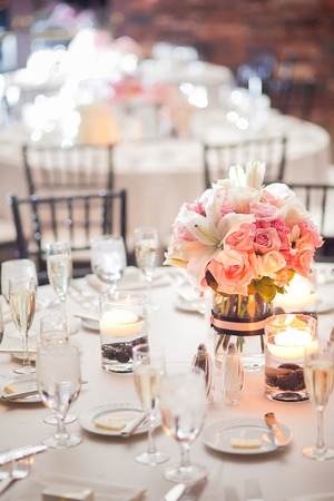 Photo for Floral centerpiece on a table at a wedding reception - Royalty Free Image