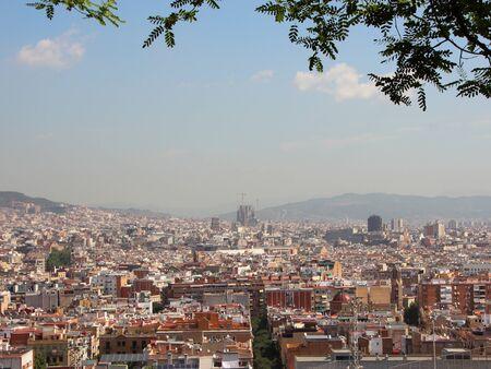 Foto de Barcelona Spain City Summer View with Sagrada Familia in Background. Smog is hiding the mountains. - Imagen libre de derechos