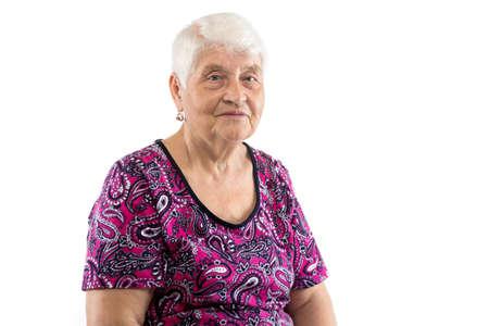 Sitting elderly lady with white hair on white background