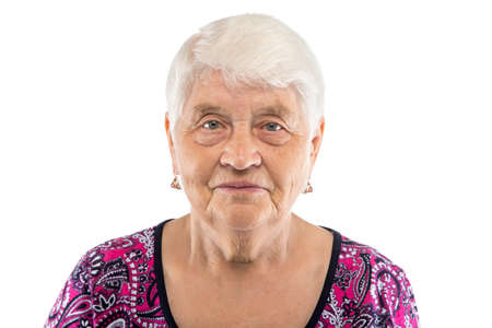 Serious elderly woman with white hair on white background