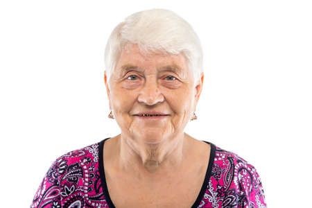 Smiling elderly woman with white hair on white background