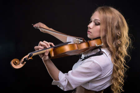 Photo for Young blond woman with violin - Royalty Free Image