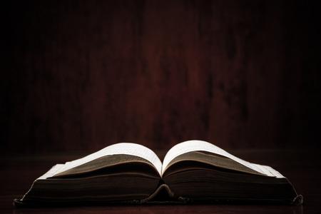 Photo pour Open holy bible on a table. Ideal for a text messages. - image libre de droit