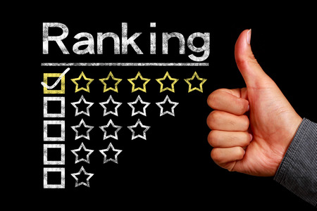 Photo pour Ranking concept is on the blackboard with thumb up hand aside. - image libre de droit