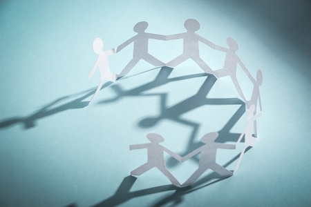 Photo for Group of people made of paper are holding hands together. Team concept. - Royalty Free Image