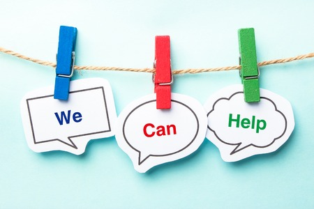 Photo pour We can help bubble with clip hanging on the line with blue background. - image libre de droit