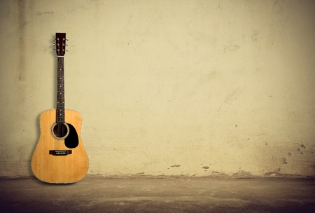 Photo for Acoustic guitar against old style wall - Royalty Free Image