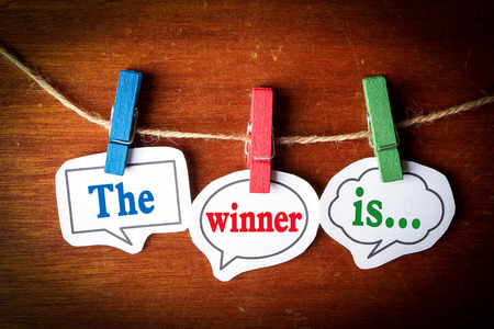 Photo for The winner is concept paper speech bubbles with line on the wooden background. - Royalty Free Image