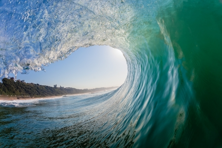Foto de Swimming surfing view of hollow crashing ocean wave inside vortex looking out   - Imagen libre de derechos