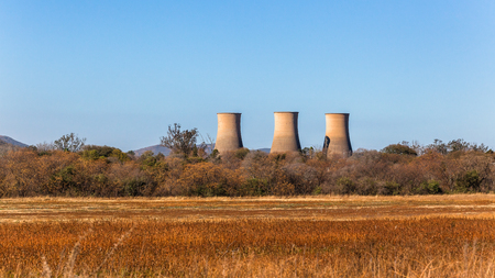 Foto de Three cooling towers structures of closed electricity supplier power station in rural countryside. - Imagen libre de derechos