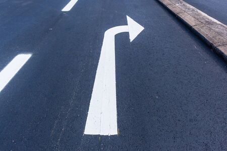 Photo for Road highway asphalt tarmac painted direction marking of white arrow sign for right turn traffic vehicle route overhead closeup photo. - Royalty Free Image