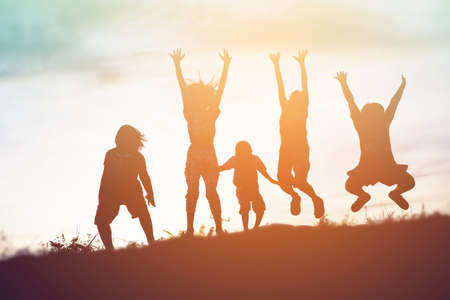 Photo pour silhouette of a happy children and happy time sunset - image libre de droit
