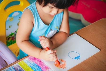 Foto de cute girl drawing with colourful crayon ,kids Coloring - Imagen libre de derechos
