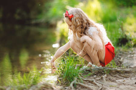Photo for Beautiful little girl having fun near river - Royalty Free Image