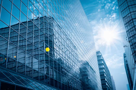 Photo for modern glass building under the blue sky with brilliant rays - Royalty Free Image