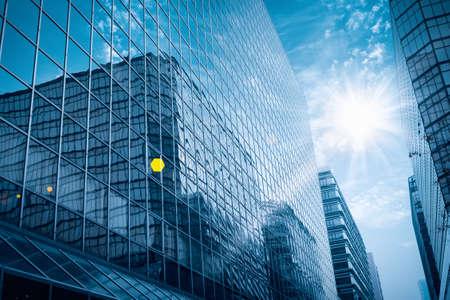 Foto de modern glass building under the blue sky with brilliant rays - Imagen libre de derechos