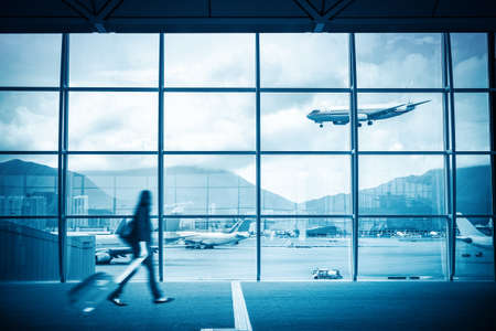 modern airport scene of passenger motion blur with window outside