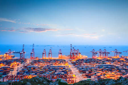 Photo for shanghai container terminal in twilight ablaze with lights   - Royalty Free Image