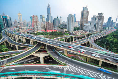 Photo pour overlooking the vehicle motion blur on shanghai elevated road junction and interchange overpass - image libre de droit