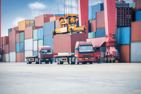 Photo for industrial crane loading containers in a cargo freight truck - Royalty Free Image