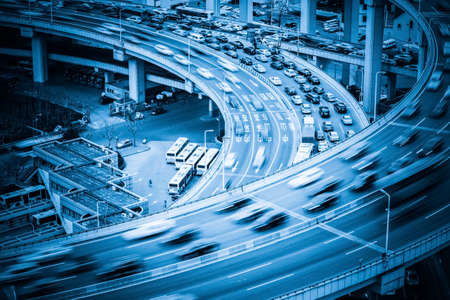 Photo pour heavy traffic closeup, vehicles motion blur on viaduct with blue tone - image libre de droit