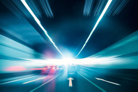 Photo for highway tunnel exit to light with speeding car motion blur - Royalty Free Image