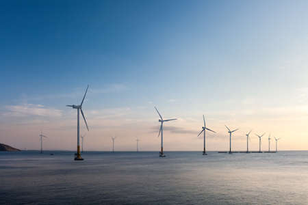 Photo for offshore wind farm at dusk, renewable energy background - Royalty Free Image