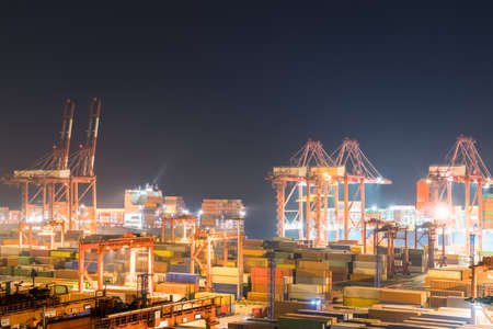 Foto de shipping container terminal at night, busy modern harbor in shanghai - Imagen libre de derechos