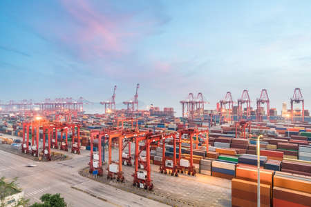 Photo pour shanghai container terminal in sunset, modern international logistics and trade background - image libre de droit