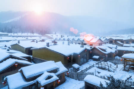 Photo pour snow township landscape in sunrise, shuangfeng forest farm, heilongjiang province, China - image libre de droit