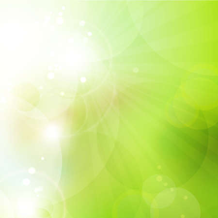 Abstract green blurry background with overlying semitransparent circles, light effects and sun burst  Great spring or green environmental background  Space for your text
