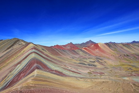 Foto de The beautiful colored Rainbow Mountain panorama near Cusco Peru. Nice view into the hole valley. Located about 20km south of Ausangate mountain. - Imagen libre de derechos