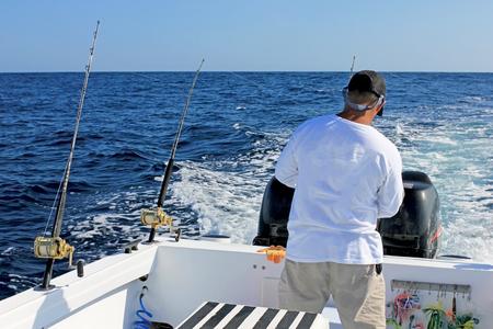 Photo pour A man fishing at the sea. - image libre de droit