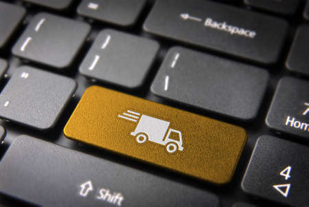 Foto de Transport delivery key with truck icon on laptop keyboard  Included , so you can easily edit it  - Imagen libre de derechos