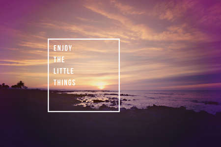 Foto de Enjoy the little things motivational inspiring quote concept with soft light sunset landscape background ideal for print card and poster design. - Imagen libre de derechos
