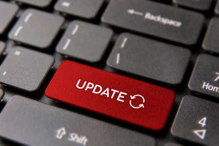 Foto de Online update computer keyboard button for internet maintenance concept. Updating process keypad key in red color. - Imagen libre de derechos