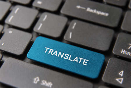Photo for Multi language translation concept: blue computer button closeup with translate text on keyboard.  - Royalty Free Image