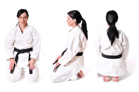 Karate woman in position isolated on white