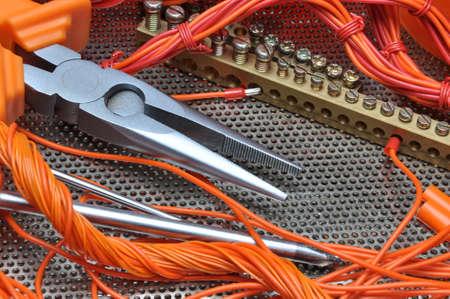 Foto de Pliers with electrical component kit - Imagen libre de derechos