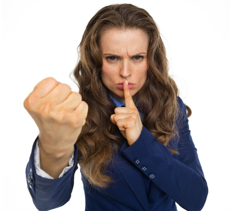 Foto de Serious business woman threatening with fist - Imagen libre de derechos