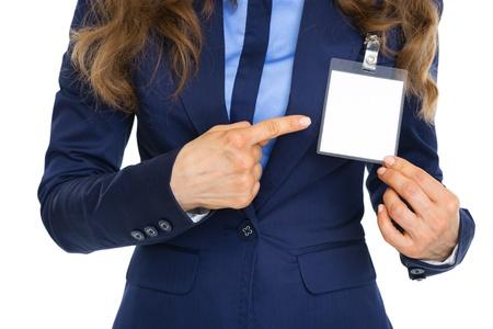 Foto de Closeup on business woman pointing on badge - Imagen libre de derechos