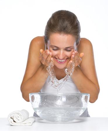 Photo pour Happy young woman washing face - image libre de droit
