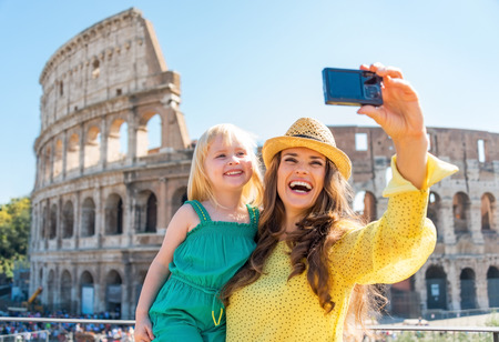 Photo for Happy mother and baby girl making selfie in front of colosseum in rome, italy - Royalty Free Image
