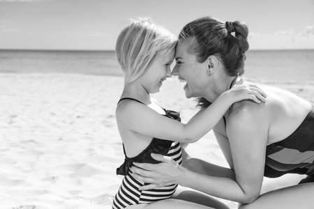 Photo for Sun kissed beauty. happy healthy mother and child in swimsuit on the seacoast embracing - Royalty Free Image